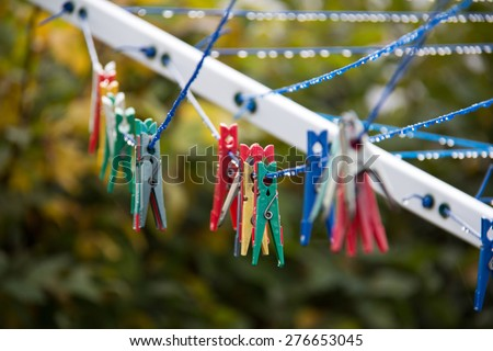 Colored clothespins / Close up of a colored clothespins on a clothesline. - stock photo