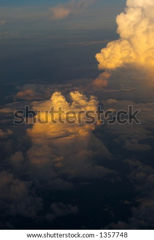Colored clouds at sunset at 30.000 feet. - stock photo