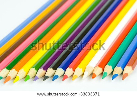 Colored crayon line up side by side