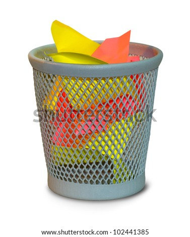 colored crumpled paper in waste basket