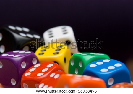 Colored Dice in  brown table - stock photo