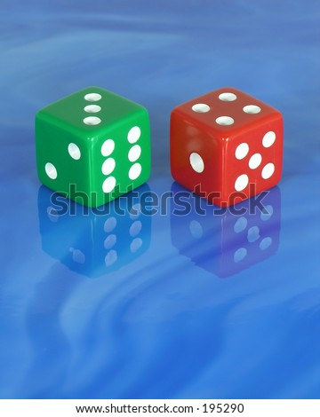 Colored dice with mirror image on blue glass tile