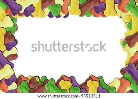 Colored dog biscuit frame on white background