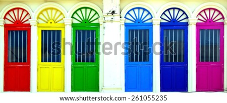 Colored doors on facade - stock photo
