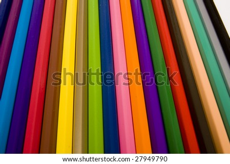 Colored drawing pencils isolated on a white studio background.
