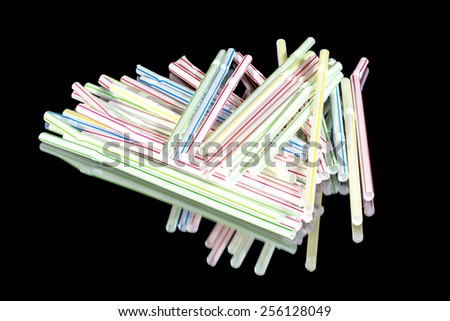 Colored drinking straws thrown in a pile - stock photo