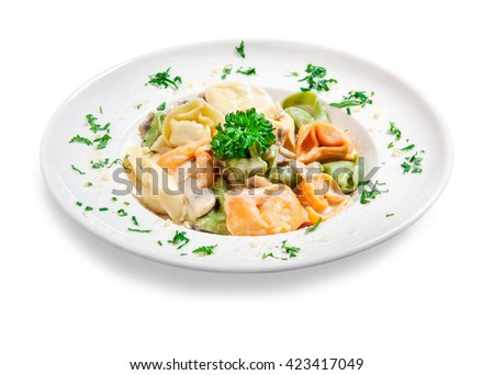 colored dumplings with mushroom sauce and grated cheese on a plate on white background - stock photo