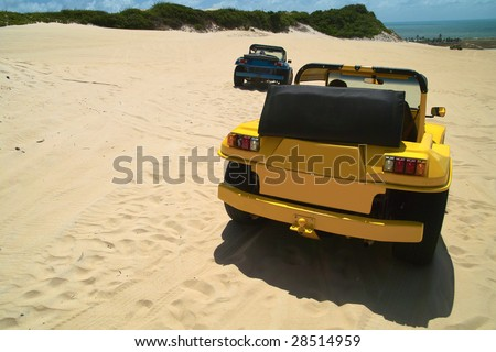 Colored dune buggys parked in the dunes of geipabu, Natal,Brazil - stock photo