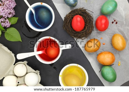 Colored Easter eggs and liquid color dyes - stock photo