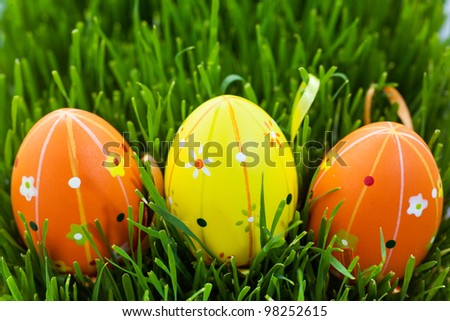 Colored Easter eggs are in green grass