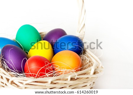 Colored Easter Eggs In A Basket Close Up On Light Background