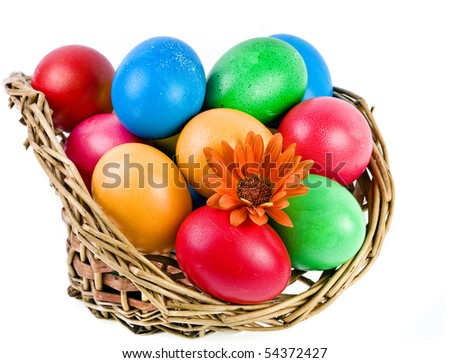colored easter eggs in a basket isolated