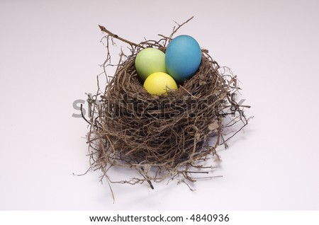 Colored Easter Eggs in Bird's Nest - stock photo