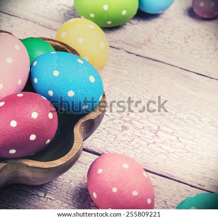 colored Easter eggs on wooden background. Focus on blue background. Toning image - stock photo