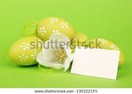 Colored eggs  and beautiful tulips with card for your text - stock photo