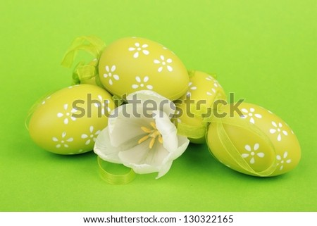 Colored eggs and beautiful white  tulips on Holiday - stock photo