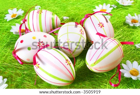 colored eggs in the grass - stock photo