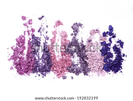 Colored eye shadow over white background - stock photo