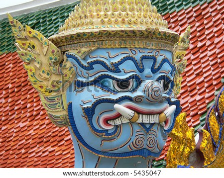 colored face of a sacred idol thailand - stock photo