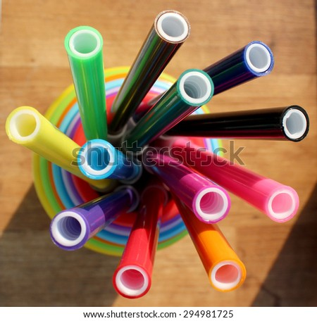 colored felt-tip pens in plastic cups - stock photo