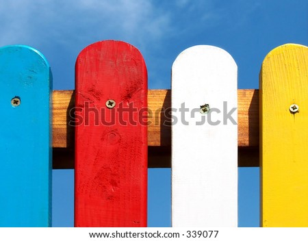 colored fence on clear blue sky background