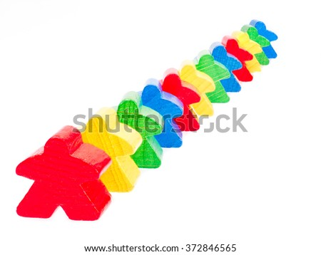 colored figures form a row on white - stock photo