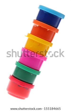 Colored finger paints for children/Bright colored cans of paint on a white background