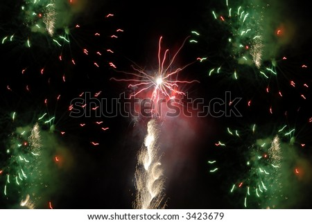 colored fireworks in the dark sky at night - stock photo