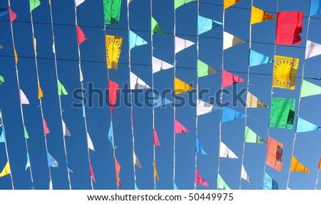 Colored flags on a blue sky