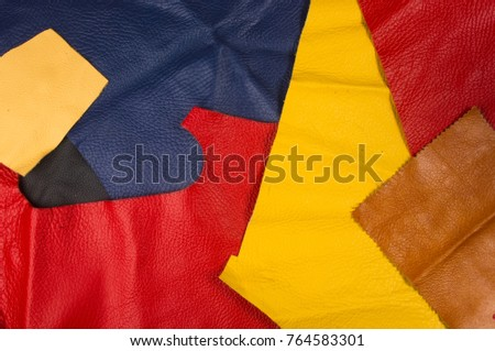 colored flaps, pieces, and scraps of natural leather for the manufactured furniture, bags and clothes