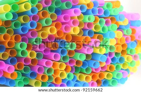 colored flexible straws in the glass isolated on white background - stock photo