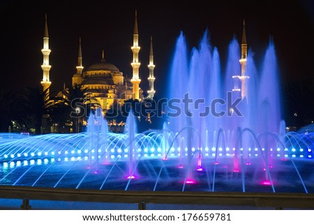 Colored Fountain and The Blue Mosque in Istanbul at Night - stock photo