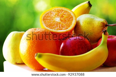 Colored fruits on table. - stock photo