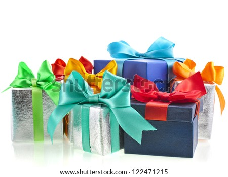 colored gift boxes with bows isolated on white background - stock photo