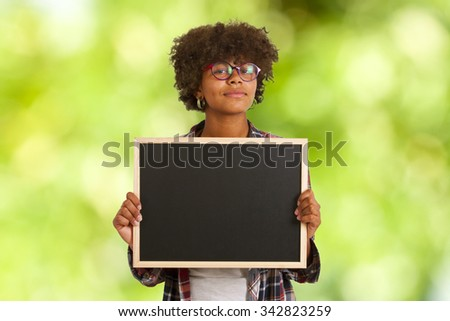 colored girl with blackboard on background - stock photo