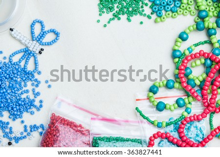 Colored glass beads and thread beads - stock photo