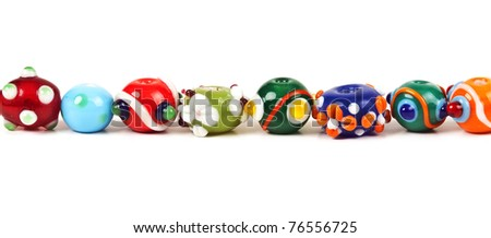 colored glass beads isolated on white background - stock photo