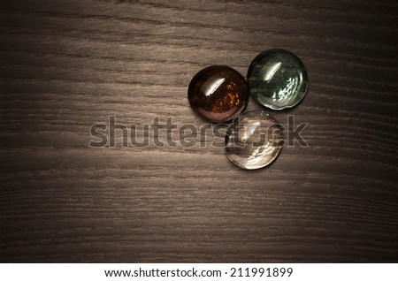 colored glass buttons, wood background