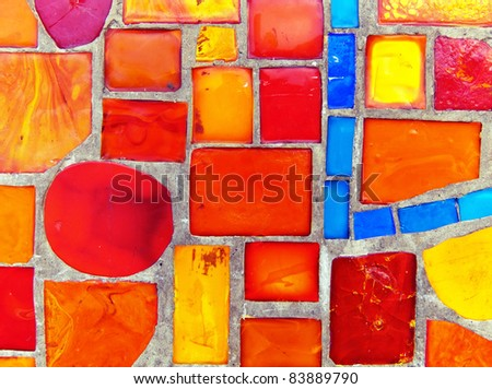 Colored glass-ceramic tiles on the wall