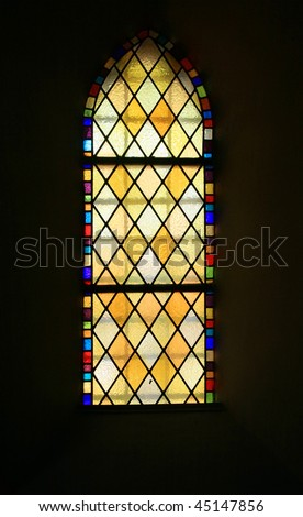 colored glass, stained window church gothic Poznan Poland - stock photo