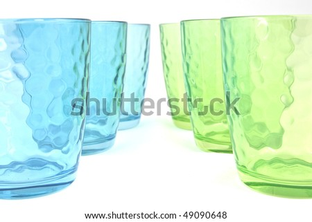 colored glasses on white background