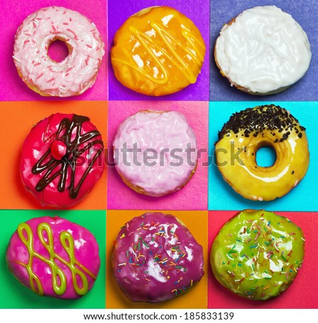 colored glazed donuts on a colored background - stock photo