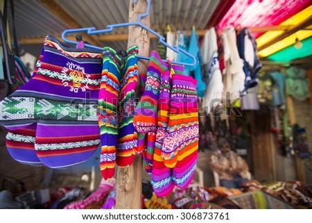 Colored gloves for Sale in Salar of Uyuni tourist market. Bolivia - stock photo