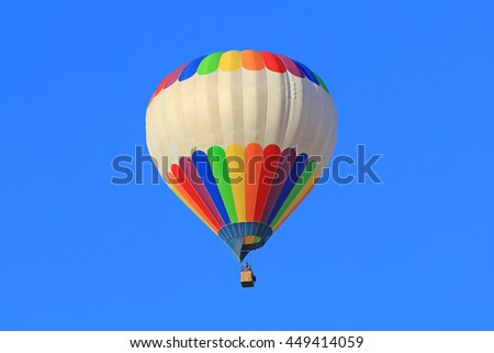 colored hot air balloon on the blue sky