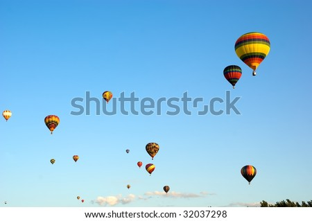 Colored Hot Air Balloons on blue sky background - stock photo