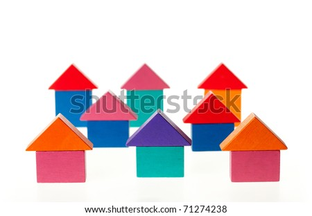 Colored houses from wooden toy blocks - stock photo