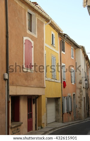 Colored houses with plastered facades in Bedoin, France - stock photo