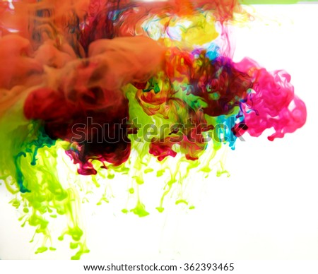 colored inks in water on white background - stock photo