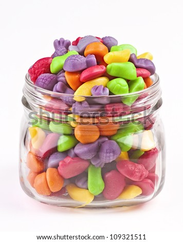 colored jelly beans in glass jar isolated on white