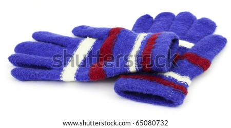 Colored knitted gloves with a white background - stock photo